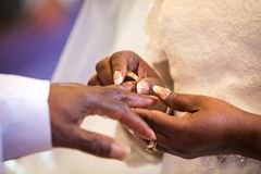 Rings exchange for black couple marriage. Ceremony Stock Photos