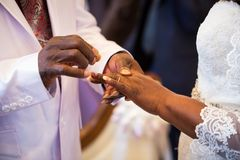 Rings exchange for black couple marriage Stock Photo