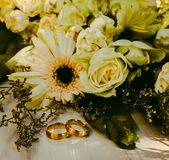 Rings Beside Flower Bouquet royalty free stock photo