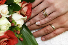 Rings and Flowers. Wedding rings and bridal bouquet royalty free stock photos