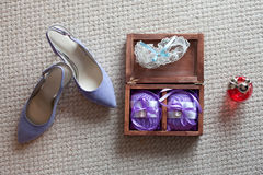 Rings, garter, perfume and shoes - bridal accessories Royalty Free Stock Photography