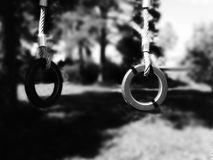 Rings for gymnastics on the Playground. Black and white photo Royalty Free Stock Photography