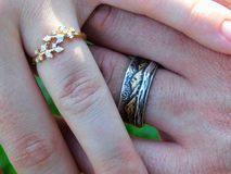 Rings of newly weds. Rings on the hands of a newly wed couple stock image