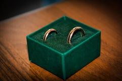 Rings Honeymoon. Gold wedding rings for newlyweds Stock Image