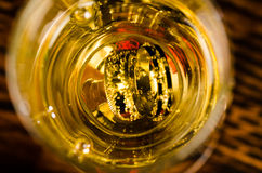 Rings inside champagne glass royalty free stock photo