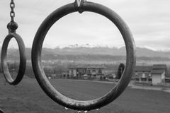 Rings. Irony encirlcled snow mountains and houses Stock Photo