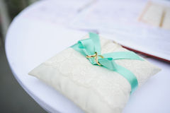 Rings on lace Pillow Royalty Free Stock Images