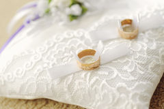 Rings on Lace Pillow. Wedding rings on white lace pillow Stock Image