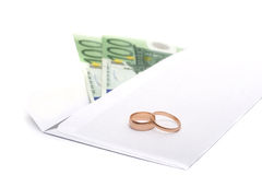 Rings, money and an envelope Royalty Free Stock Photography