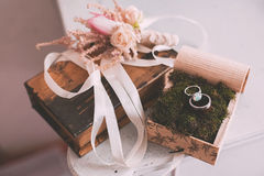 Rings on moss and buttonhole on book Stock Photography
