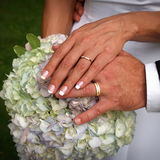 The Rings. Newly married couple with their rings and flowers stock images