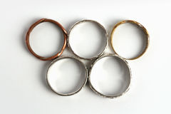 Rings with olympic games symbol. Still life metallic rings with olympic games shapes Stock Photography