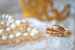 Rings and pearls. Wedding rings with a pearl necklace Stock Photo