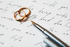 Rings and pen Royalty Free Stock Photo