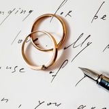 Rings and pen Royalty Free Stock Photography