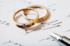 Rings and pen Stock Image