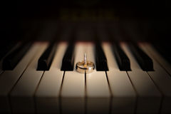 Rings on piano Stock Photos
