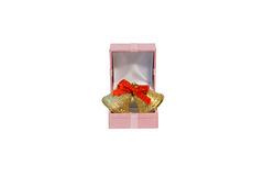 Rings in the pink holiday box Stock Photos