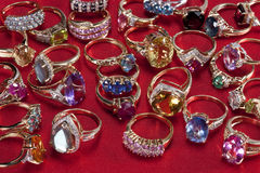 Rings with precious & semi-precious gemstones. Valuable collection of gold rings with precious & semi-precious gemstones Stock Photography