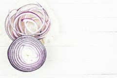 Rings of purple onion. Fresh red onion on a light table stock photography