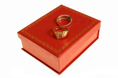 Rings on red box. Image of two rings put on red gift box Royalty Free Stock Photography