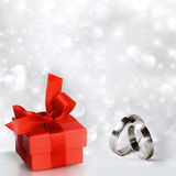 Rings with red gift package Royalty Free Stock Image