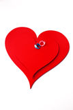 Rings on red hearts. Two rings on red hearts Royalty Free Stock Photo