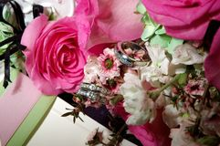 Rings resting on the Bouquet stock photography