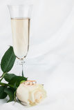 Rings, rose and champagne glass Royalty Free Stock Photography