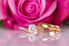Rings and rose. Royalty Free Stock Photography