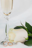 Rings, rose and one champagne glass Royalty Free Stock Image