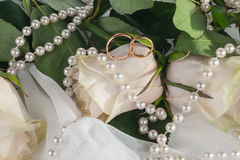 Rings, roses and necklace Stock Image