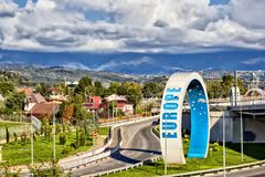 Rings at roundabout in Adler. Mountain view and olympic rings at the roundabout `Adlerovskoe kol`co` in Adler. Sochi, Russia Stock Photos