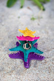 Rings on starfishes in tropic paradise. Wedding Vacation concept Royalty Free Stock Image