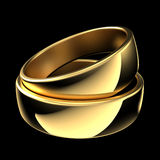 Rings. Two golden wedding rings isolated on black background Royalty Free Stock Photo
