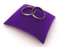 Rings on a velvet cushion Stock Image