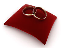 Rings on a velvet cushion Stock Photography