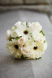 Wedding bouquet and rings Stock Images