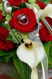 Rings in wedding bouquet of roses. An callas Stock Images