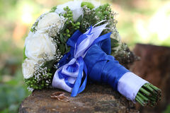 Rings and wedding bouquet on wood Royalty Free Stock Photography