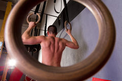 Rings workout man at gym hanging Stock Images