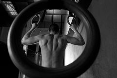 Rings workout man at gym hanging Royalty Free Stock Photos