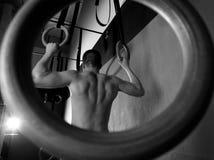 Rings workout man at gym hanging Stock Image