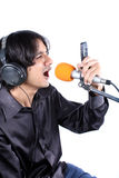 Ringtone Singer. A metaphorical image of a singer recording a ringtone / dialler-tone for a record company in music studio, on white studio background Royalty Free Stock Image