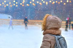 Rink. Winter ice skating rink. And a girl stock photos