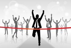Rinnande affärsmanCrossing Finish Line seger Arkivfoto