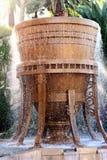 Rinnande brun vattenspringbrunn Royaltyfri Foto