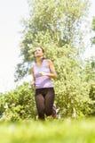Rinnande jogga för kvinna royaltyfri foto