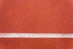 Rinnande löparbana och linje Arkivfoto