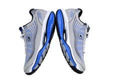 Rinnande skor - gymnastikskor - instruktörer, i grå färger och blått Arkivfoton